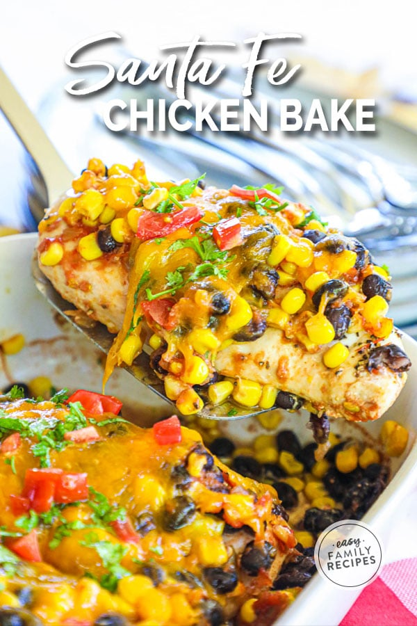 Santa Fe Chicken breast being lifted from casserole dish