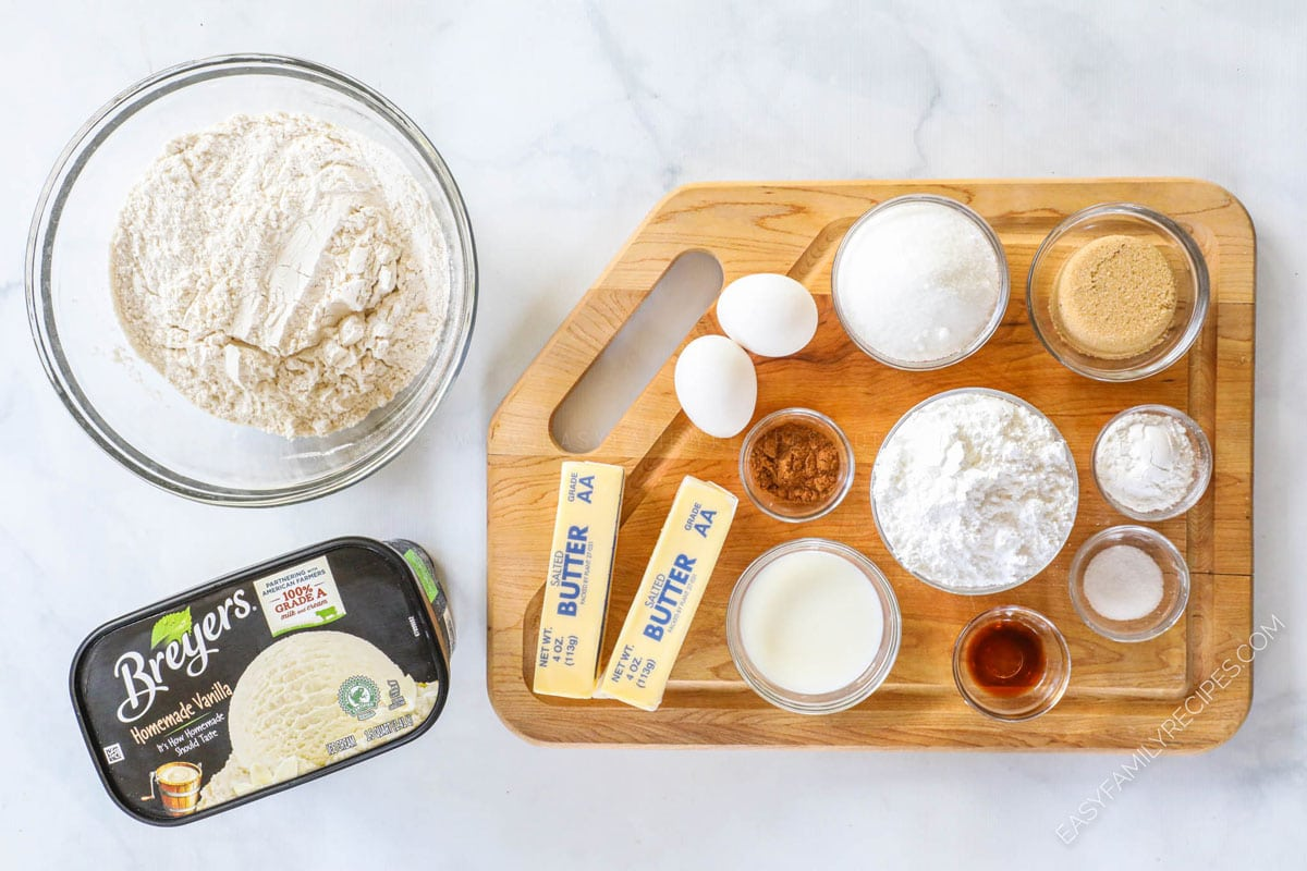 Ingredients for cinnamon swirl cake including flour, sugar, melted ice cream, butter, eggs, salt