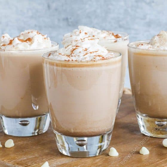Four Homemade White Chocolate Chai Tea Lattes topped with whipped cream and cinnamon