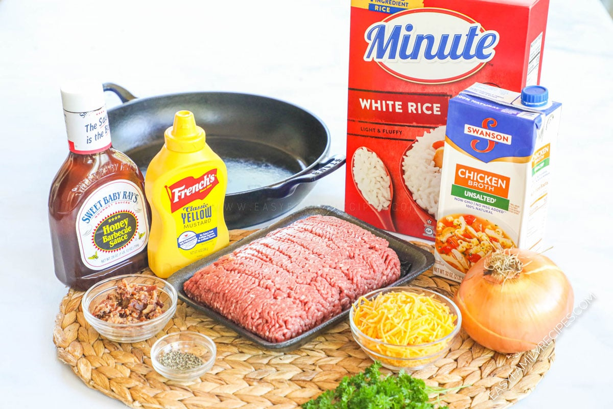 Ingredients for making Bacon Cheeseburger Rice - ground beef, onion, bbq sauce, broth, and cheese