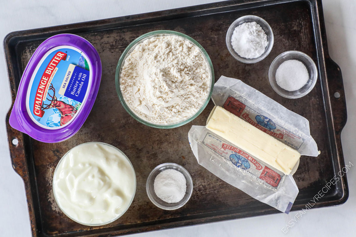 Ingredients for making No Yeast Dinner Rolls including flour, yogurt, butter, baking soda, sugar, and salt