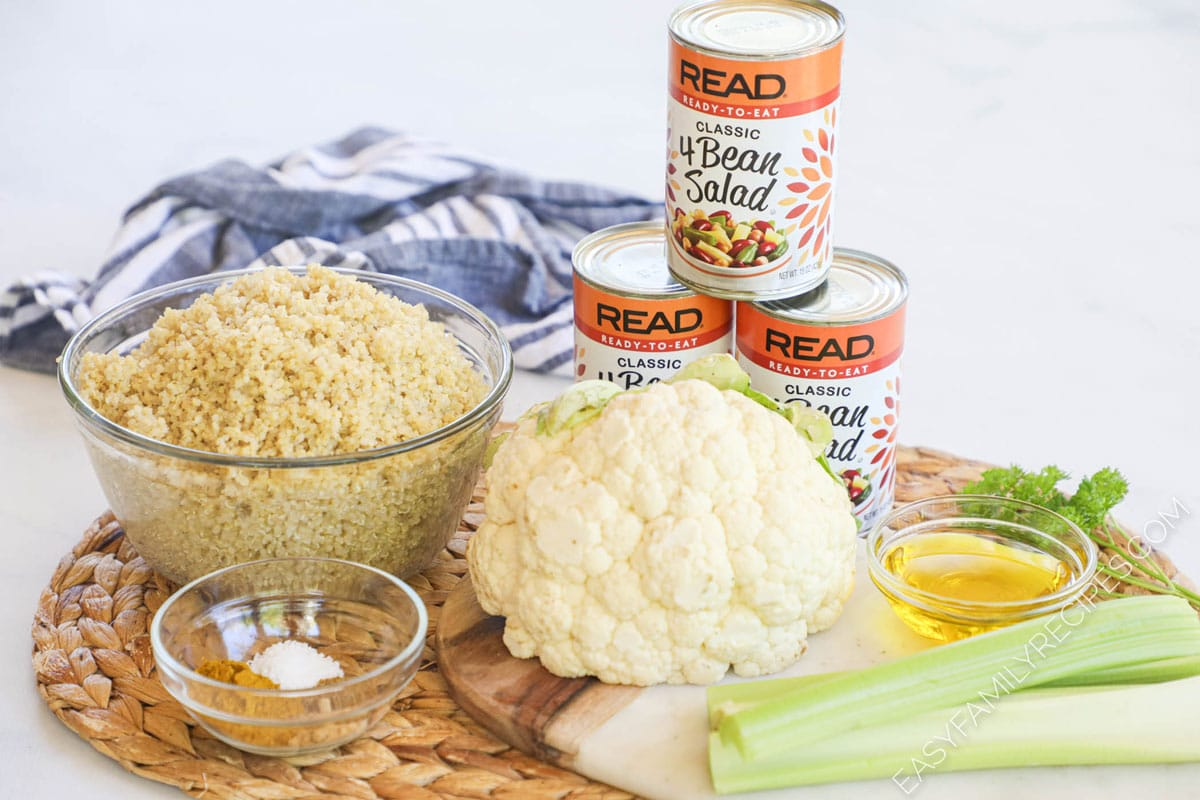 Ingredients for Chilled Curried Quinoa Salad including Quinoa, cauliflower, celery, spices, 4 bean salad, and oil.