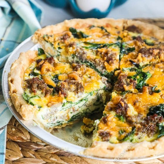 Deep Dish Spinach Sausage Quiche cut into slices