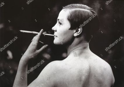 Erotisme Stock Photos  Editorial Images and Stock Pictures     Woman smoking  Erotic postcard  France  ca 1930
