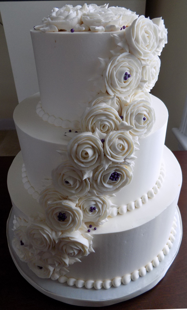 Buttercream Wedding Cakes York PA   Buttercream wedding cakes     3 Tier buttercream wedding cake  decorated with cascading ivory buttercream  roses and deep purple sugar