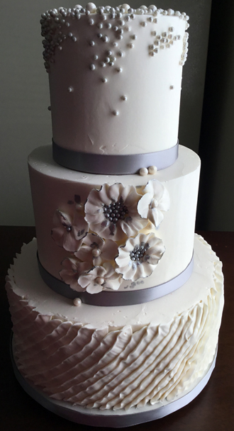 Buttercream Wedding Cakes York PA   Buttercream wedding cakes     3 Tier buttercream wedding cake decorated with buttercream pleats  silver  and pearl sugar pearls dragees and buttercream flowers with silver high  lights