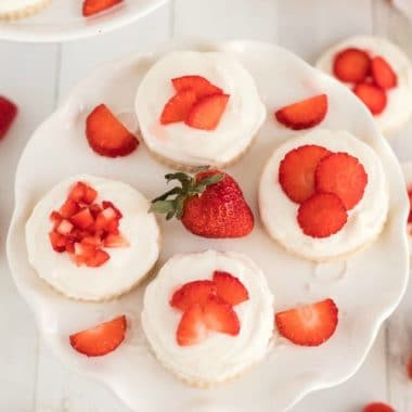 Strawberry shortcake cookies are a delicious sugar cookie topped with whipped cream and fresh sliced strawberries. Every sweet bite reminds you of traditional strawberry shortcakes!