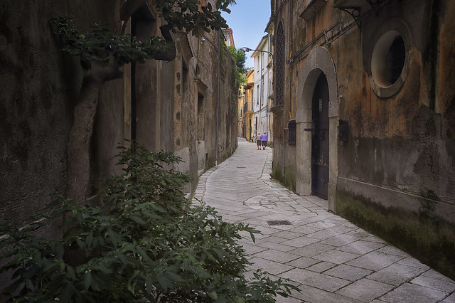 Two Old Ladies Walking Down The Street In Sant Agata De