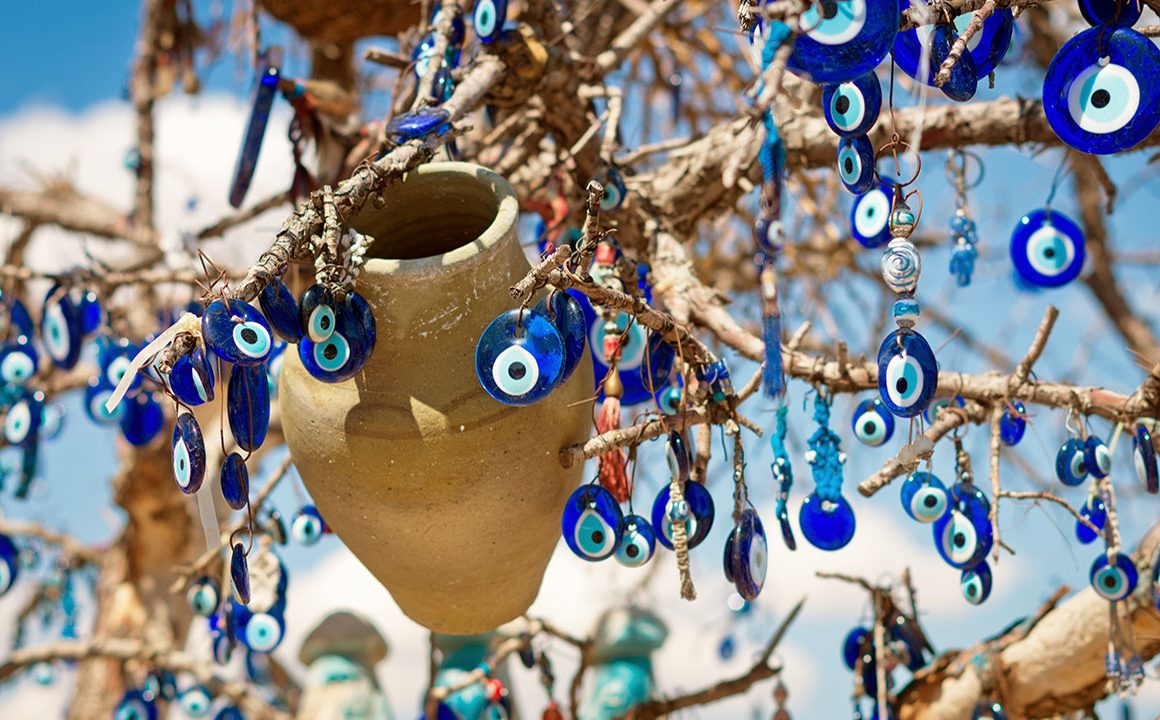 evil-eye-jewelry-hanging-in-tree