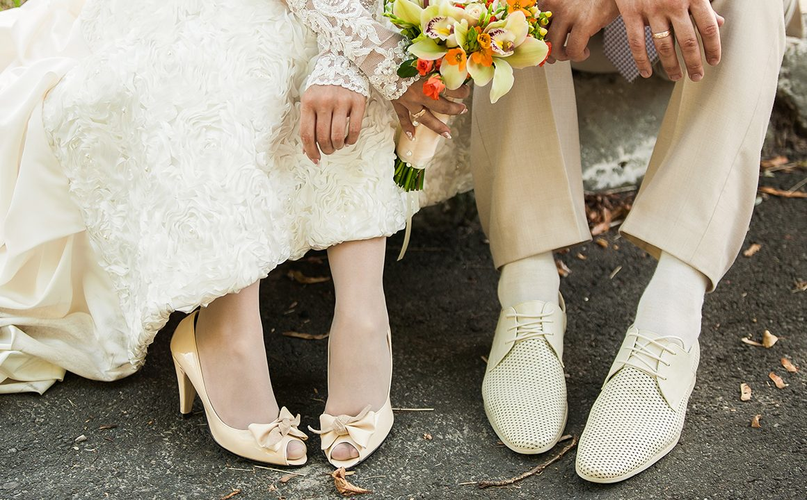 feet-of-a-bride-and-groom-in-cute-shoes
