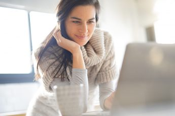 Are-Practice-Tests-the-Best-Way-to-Pass-the-Microsoft-MD-101-Exam-woman-staring-at-computer-screen-main-image