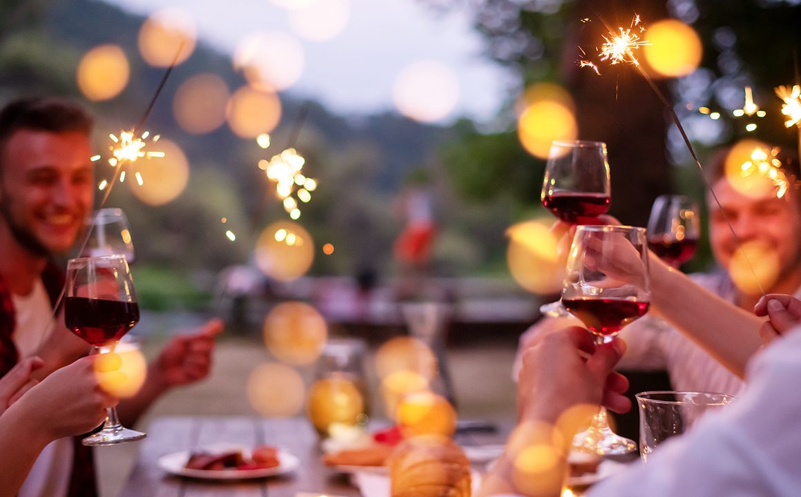 celebrate-with-wine-friends-celebrating-at-a-table-drinking-wine