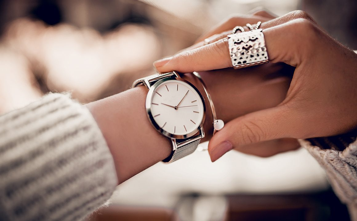 elegant-watch-woman-looking-at-beautiful-watch-on-her-wrist
