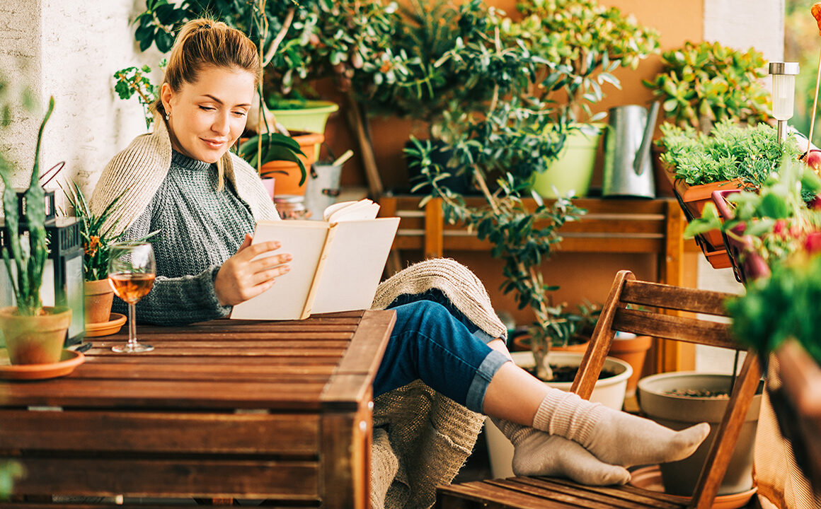 stress-busters-during-covid-woman-sitting-at-home-peacefully-reading