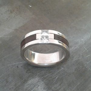 custom white gold wedding ring with wood inlay and center diamond top view