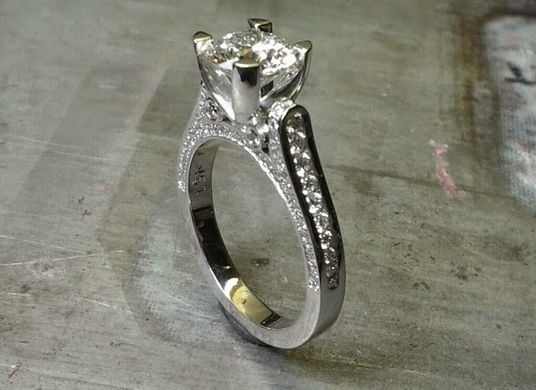 custom designed engagement ring with band embellishments and a cathedral set diamond side view