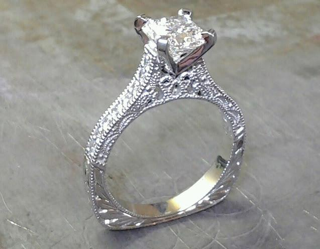white custom filigree engagement ring with princess diamond in channel setting front view