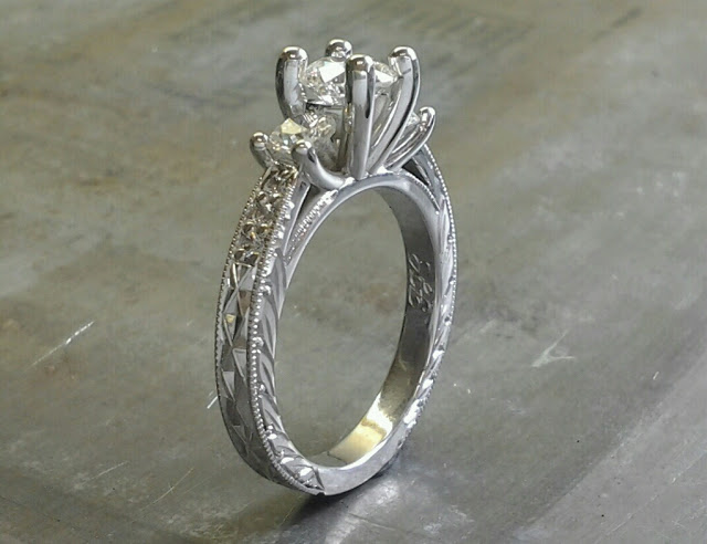 custom filigree white gold band with leaf accents and a triple cathedral set of diamonds with matching diamond band side view