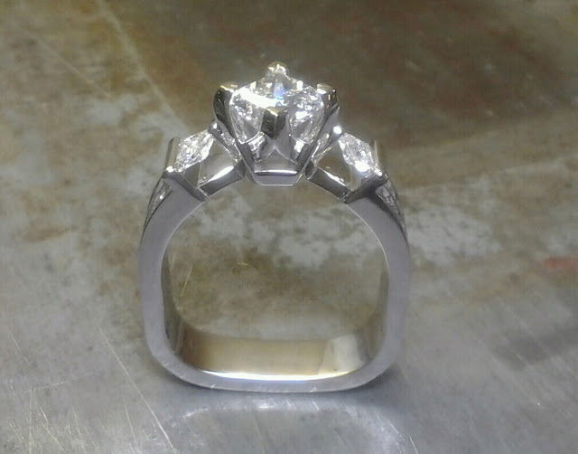 square shaped ring with triple set diamonds