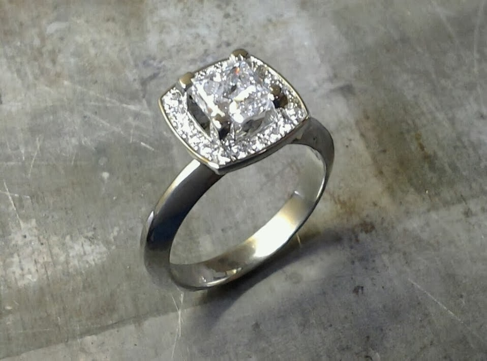 band with princess cut diamond in square halo setting