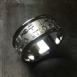 custom wedding ring with symbol engraving
