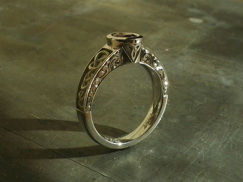 celtic inspired engagement ring with knots and triquetra symbol