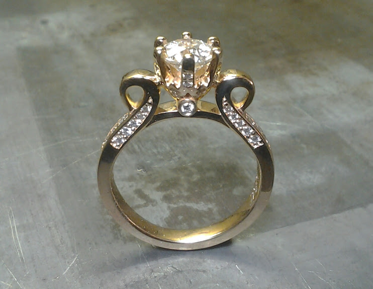 victorian style gold engagement rings with diamond band, princess cut center diamond in a cathedral setting and small accent diamonds
