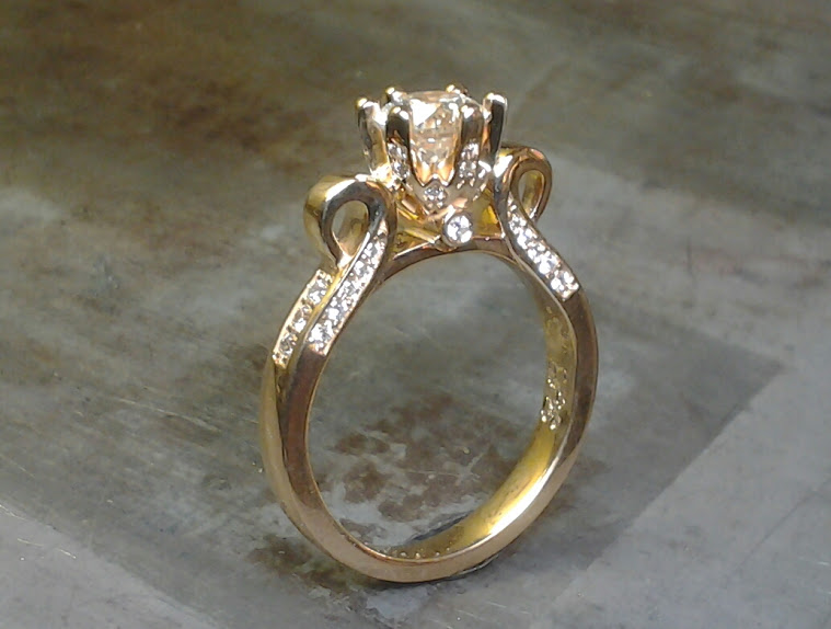 victorian style gold engagement rings with diamond band, princess cut center diamond in a cathedral setting and small accent diamonds side view