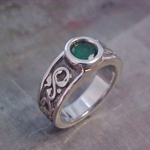 rustic custom engraved ring with emerald