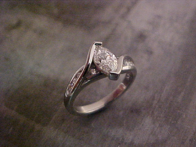 custom designed engagement ring with marquise diamond in tension setting