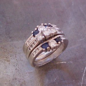 custom ring with blue sapphires and diamonds in channel setting