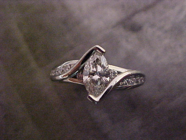 custom designed engagement ring with marquise diamond in tension setting top view