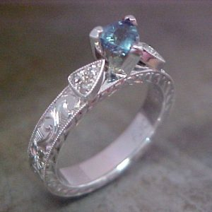 custom 14k white gold engagement ring with light blue center sapphire
