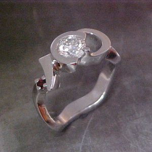 assymetrical band 14k white gold ring with rubies and diamond center stone