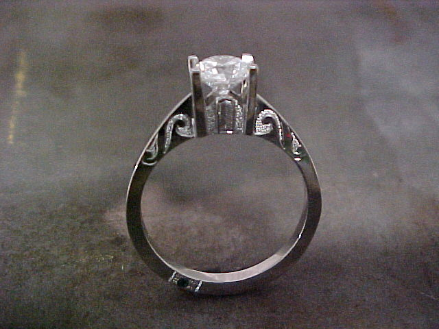 custom engagement ring with engraving and princess cut tension set diamond