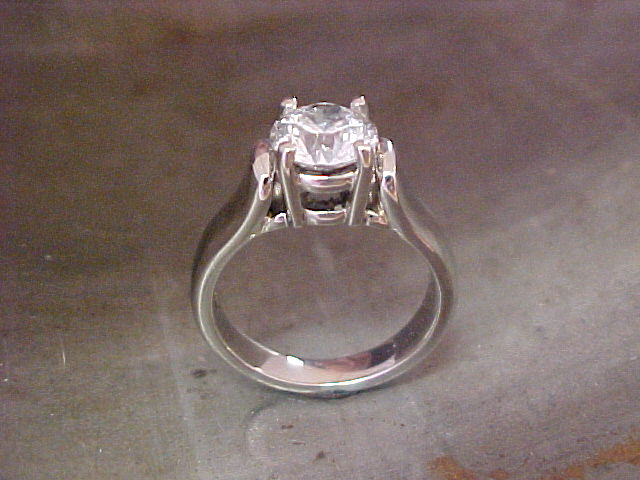 custom engagement ring with white gold and large round diamond