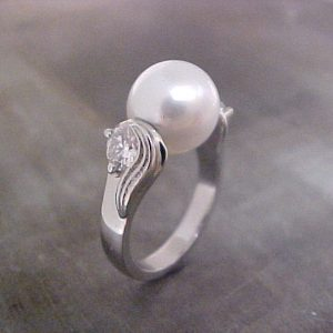 white gold ring with floating pearl
