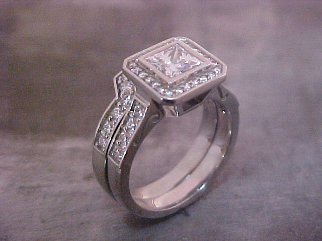14k white gold custom engagement ring with matching wedding band and many diamonds