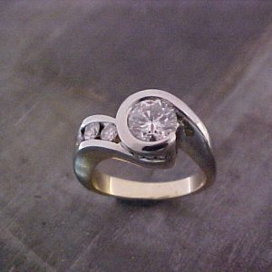 custom assymetrical ring with large center diamond