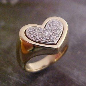 gold heart ring with diamonds and white gold