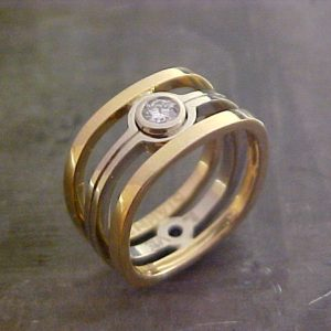 custom wedding ring with yellow and white gold and solitary round diamond