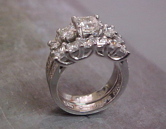 white gold custom engagement ring with diamond cluster and matching wedding band