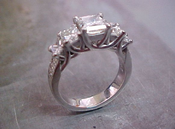 white gold custom engagement ring with diamond cluster