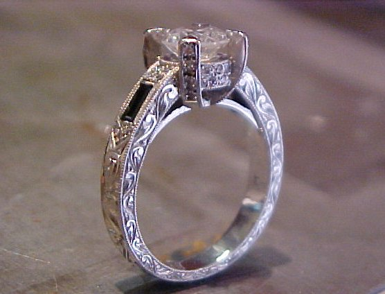 large custom engagement ring with engraved band and side accents