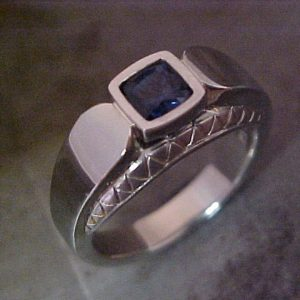 14k white gold custom ring with sapphire center gem