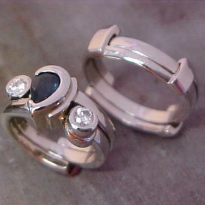 matching custom wedding rings with sapphire accent