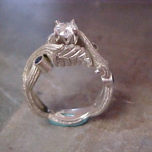 custom engagement ring with vine engraved band and saphire accents side view