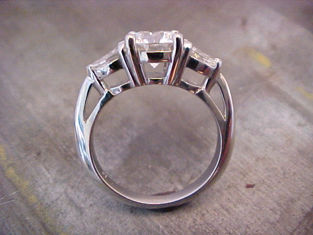 custom three stone engagement ring side view