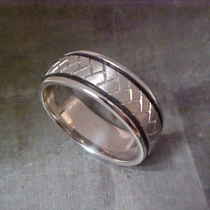 custom wedding band with black accents and engraving side view