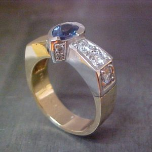 custom white gold ring with sapphire center stone